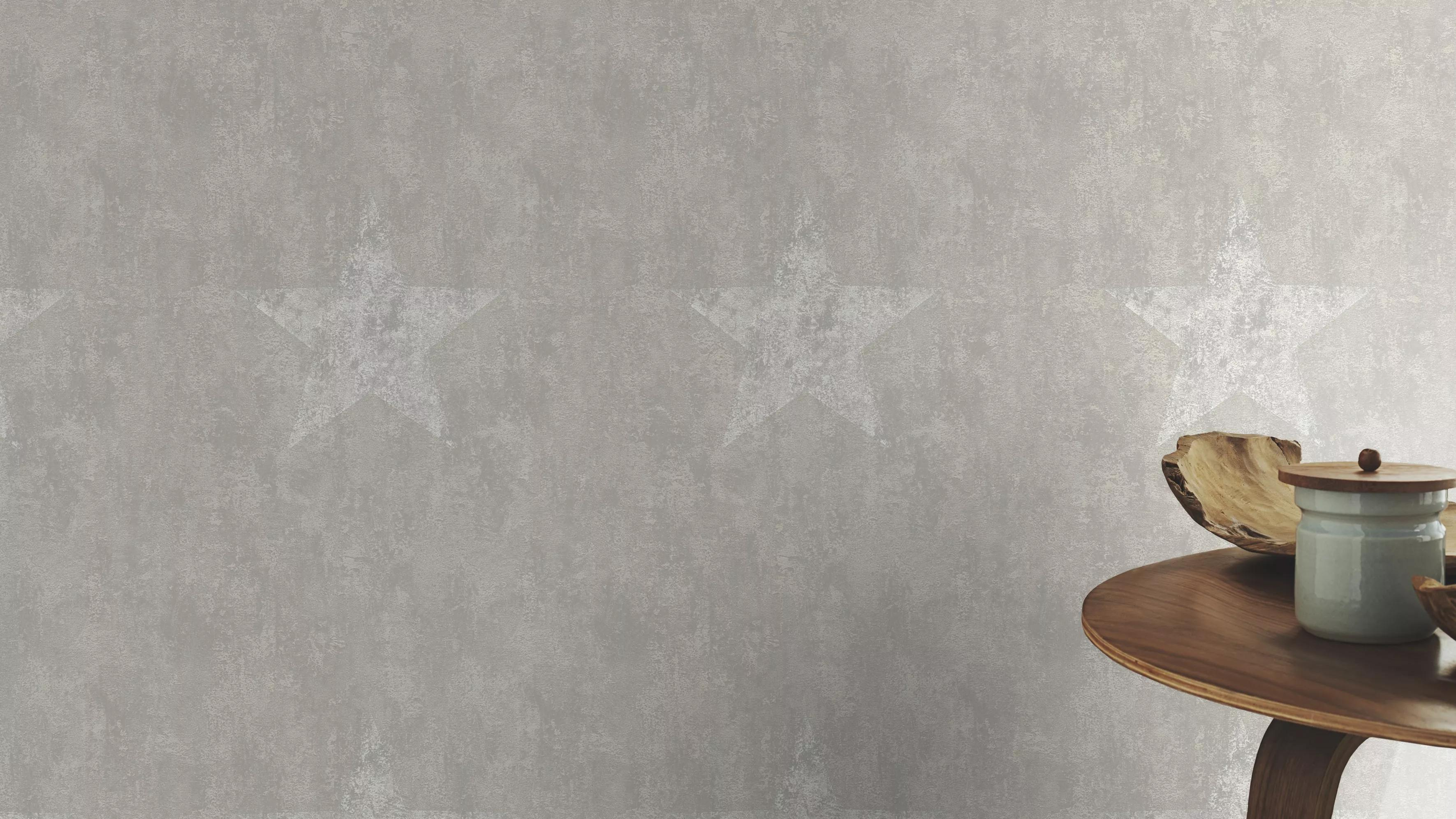 Szürke betonhatású alapon csillag mintás vlies tapéta